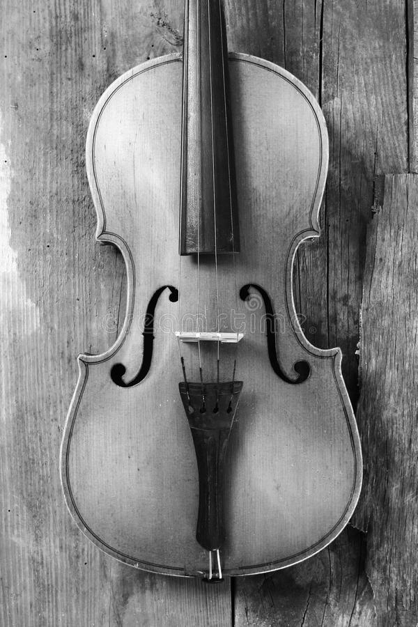 Old violin in a workshop. An old violin in the conservator`s workshop stock photos