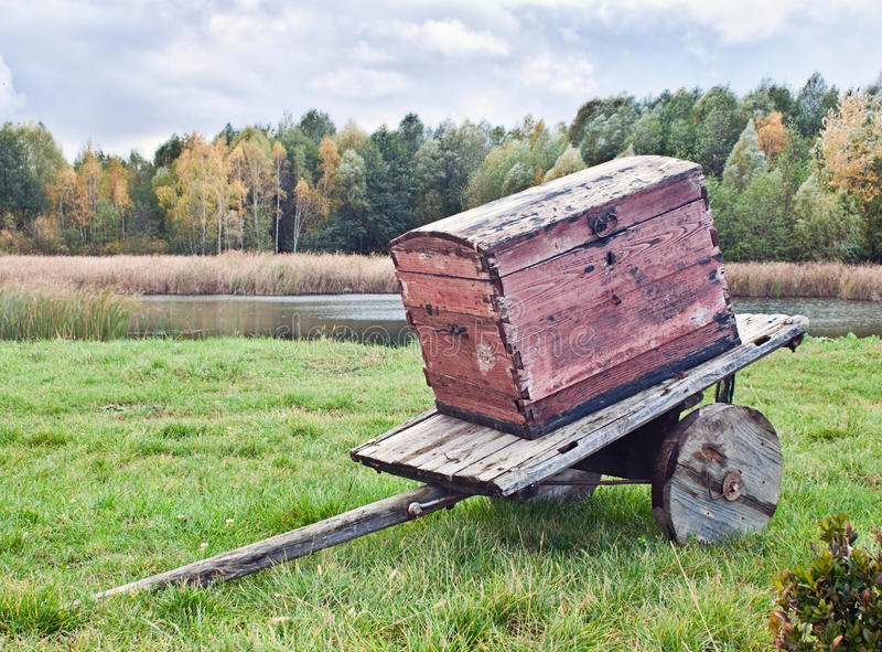 Old wagon. With a chest against the autumn landscape royalty free stock images