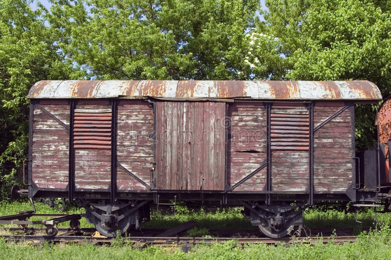 Old wagon. Old rusty train wagon on the old station stock image