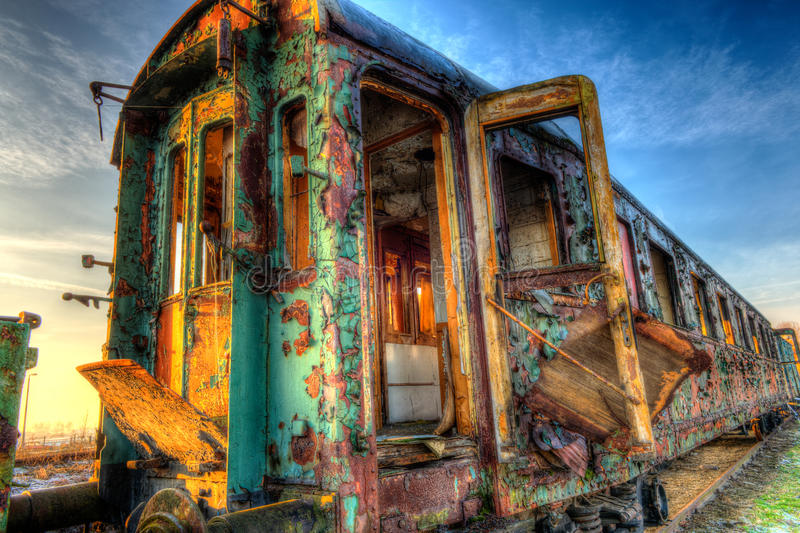 Old wagon of train. Old abandoned railway wagon standing on the siding, photo hdr royalty free stock photo