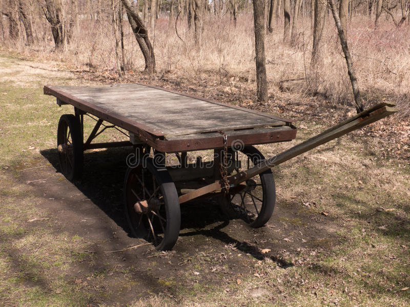 Old Wagon. Utilitarian flat bed wooden wagon updated just a bit with rubberized wheels to make it functional royalty free stock images