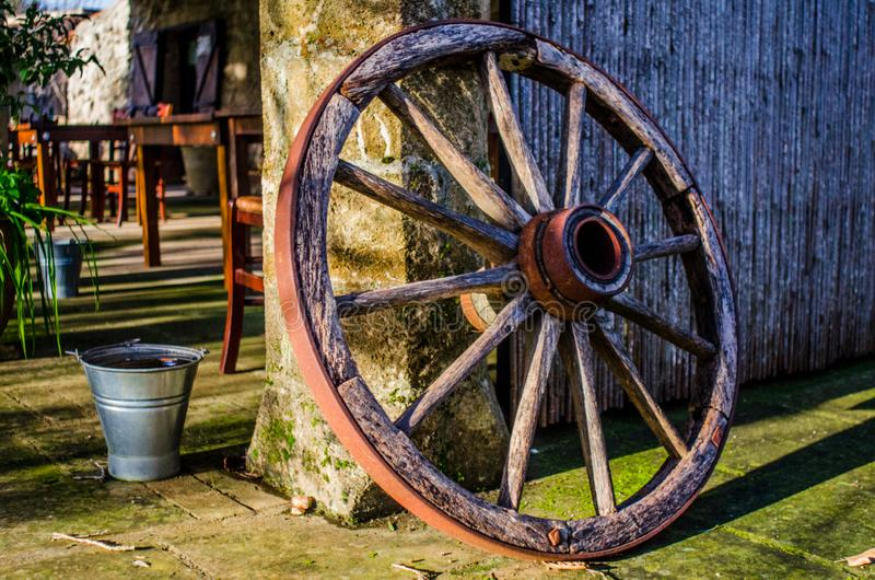 Old wagon wheel. With slight HDR and very nice background stock photography