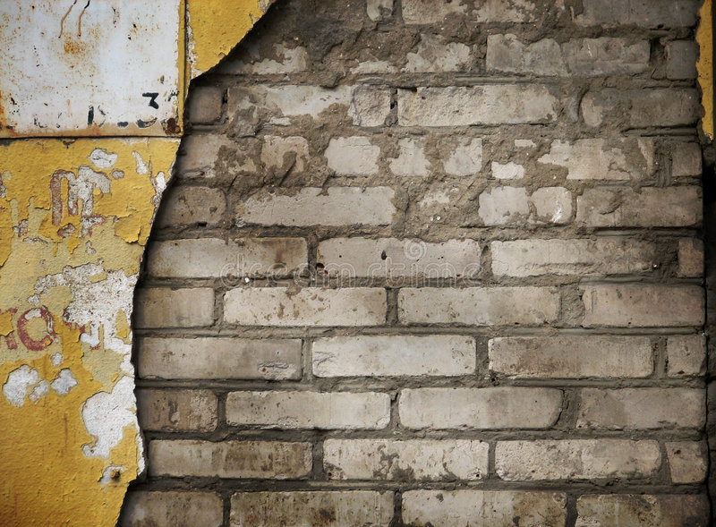 Old wall. With bricks showing through the surface royalty free stock image