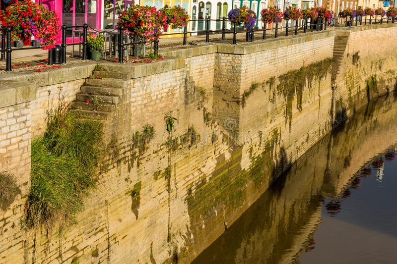 Old wall of central canal in Bridgwater. River Parrett in Bridgwater passes through downtown through a beautiful old canal royalty free stock photography