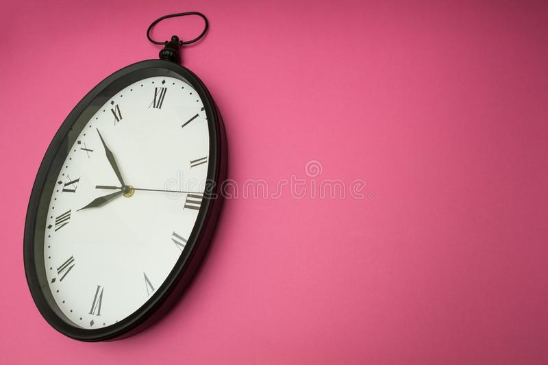 Old wall clock on a pink background stock photos