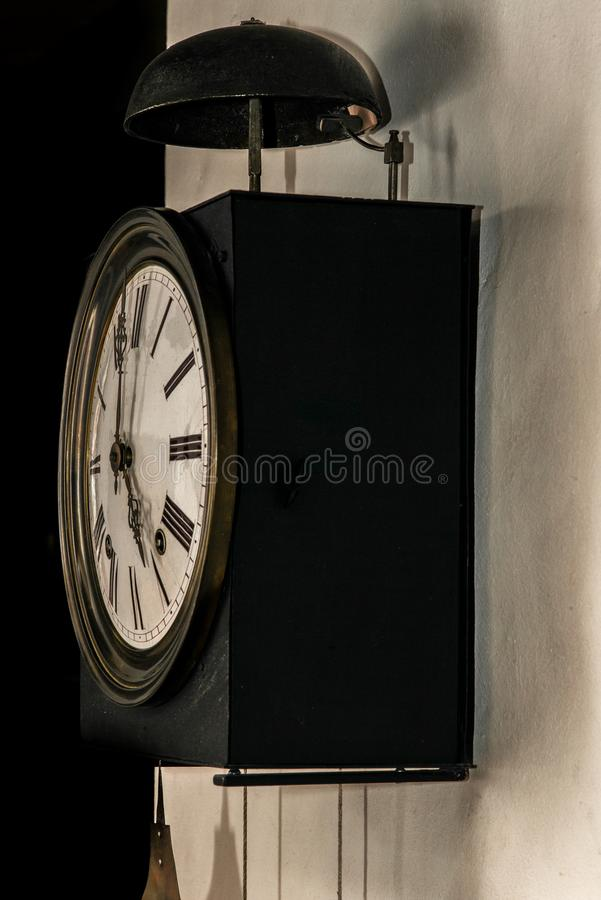 An old wall clock in Switzerland stock photography