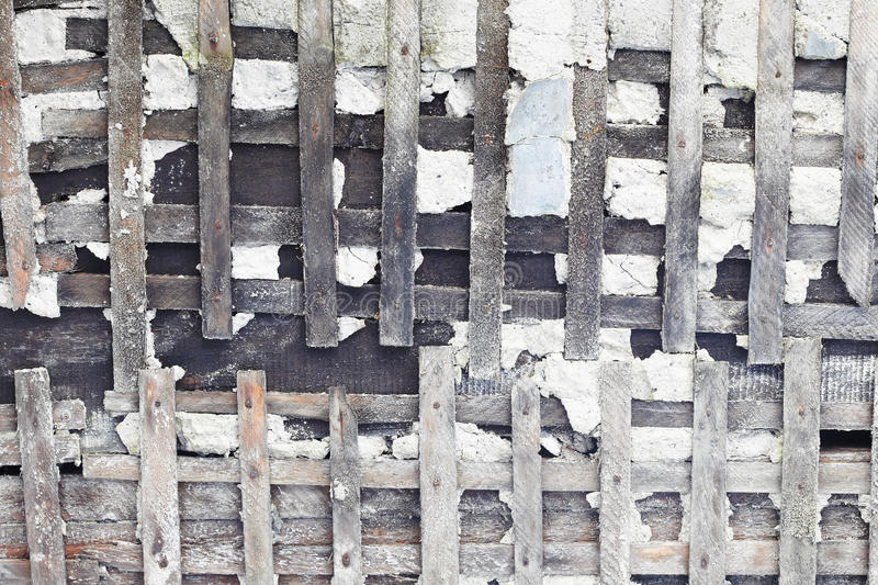 Download Old Wall Is Destroyed. Wooden Skeleton Is Bared. Stock Image - Image: 15645261