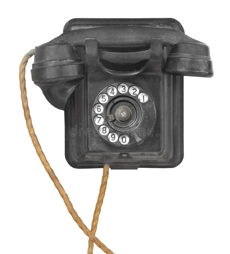 Old wall dial telephone isolated. Old and worn black wall mounted dial type telephone. Isolated on white stock photos