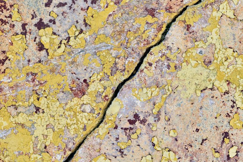 Old wall with falling off paint and plaster. On diagonally much fissure. stock photos