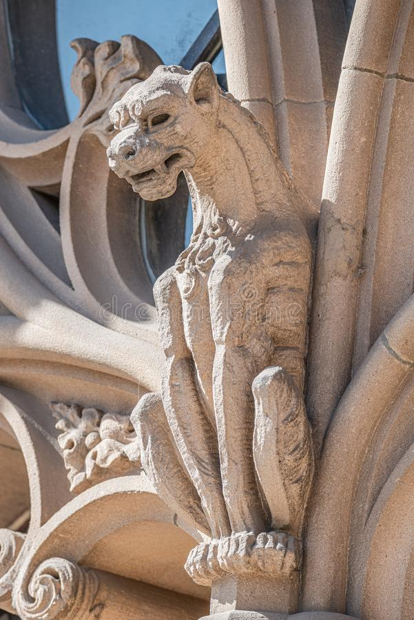 Old wall figure of scary dragon at main facade of Justice Palace in Magdeburg, Germany stock photography