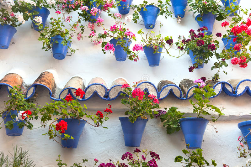 Old Wall with Flowers Decorations, European Street, Spain stock images