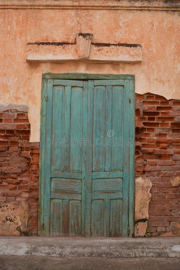 Old wall with framed green door royalty free stock photo