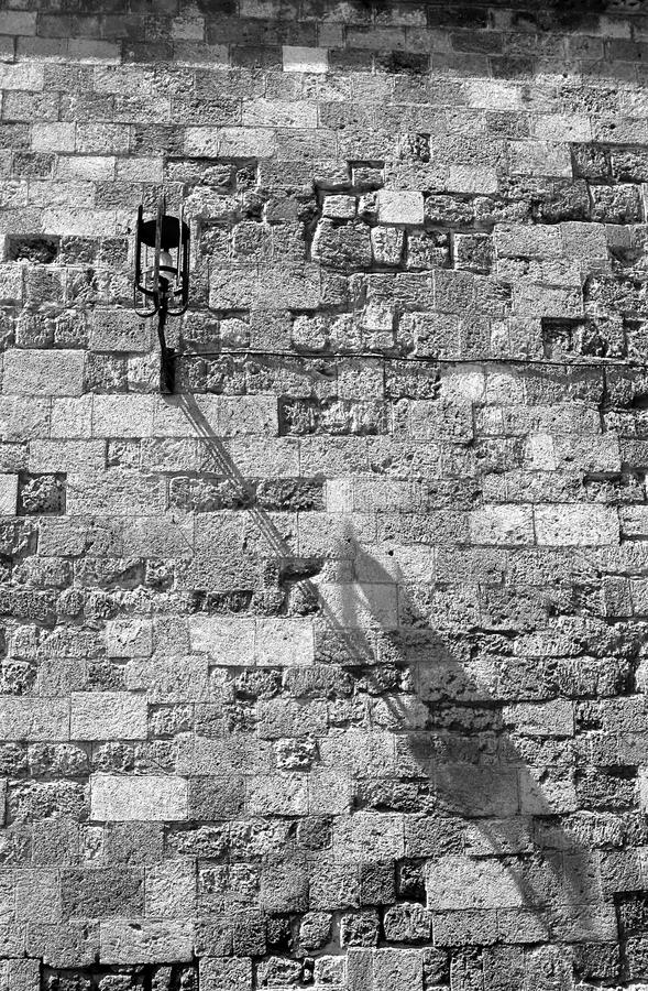 Old wall with lantern stock photos