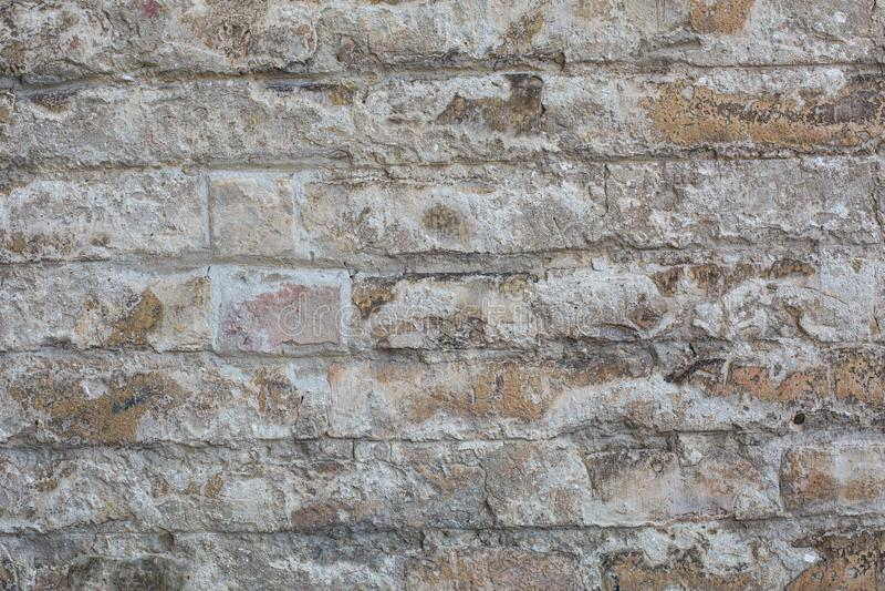 Old wall made of big stones and broken bricks royalty free stock photos