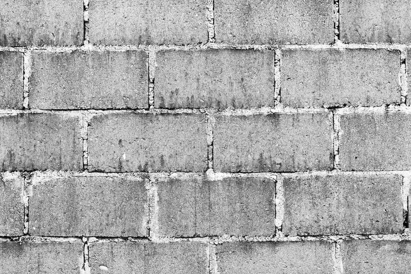 Cinder Block Wall Black and White. Old wall made from cinder blocks as background texture in black and white royalty free stock images