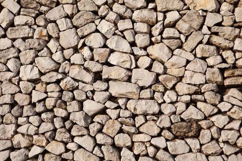 Old wall made of light stones stock image