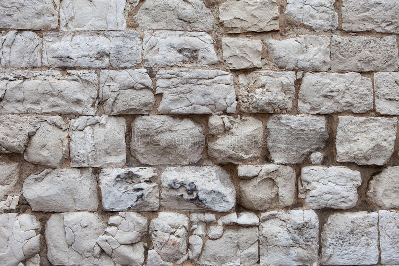 Old wall made of light stones stock photo