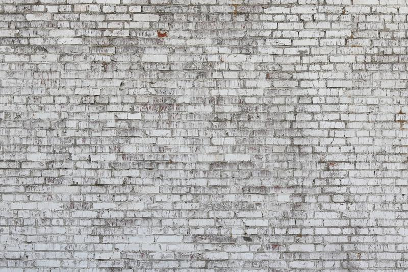 Old wall made of red brick, painted white in loft style. For modern designer interior of room, bar or restaurant royalty free stock photography