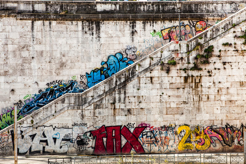 Old wall with murals and graffito. Stairway. Rome, Italy stock photos