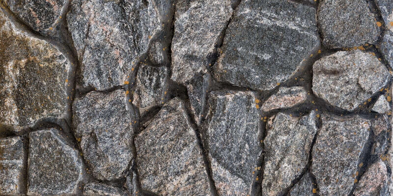Old wall of natural stone. Abstract background.  royalty free stock photos