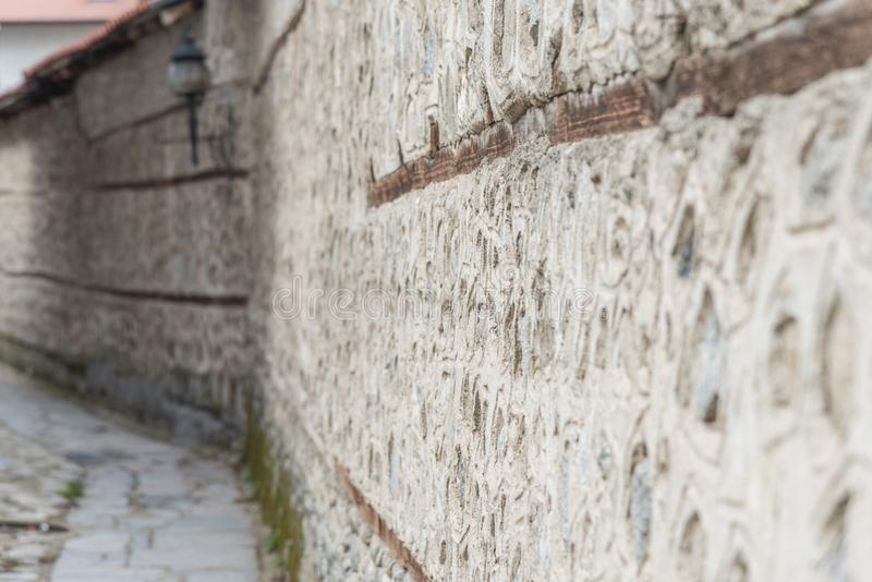 Old wall stone perspective. Wall of stone on the old street in the street in perspective royalty free stock photography