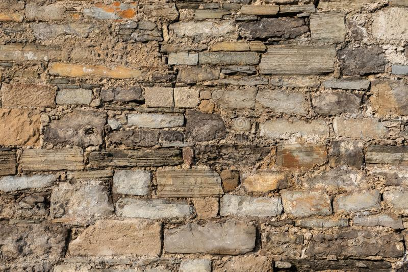 An old wall with a stone of yellow hues. Background stock image