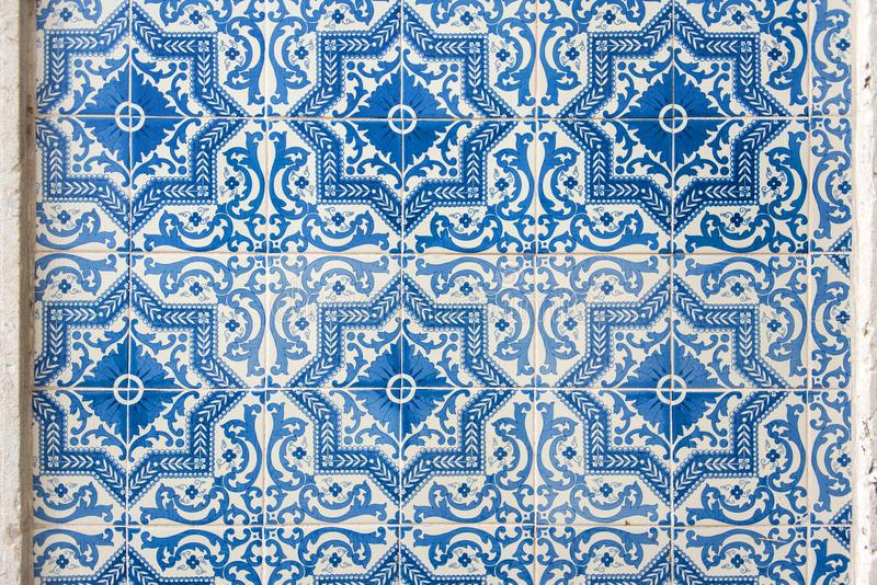 Old wall with traditional Portuguese decor tiles azulezhu in blue tones. Old wall with traditional Portuguese decor tiles azulezhu in blue tones stock photos