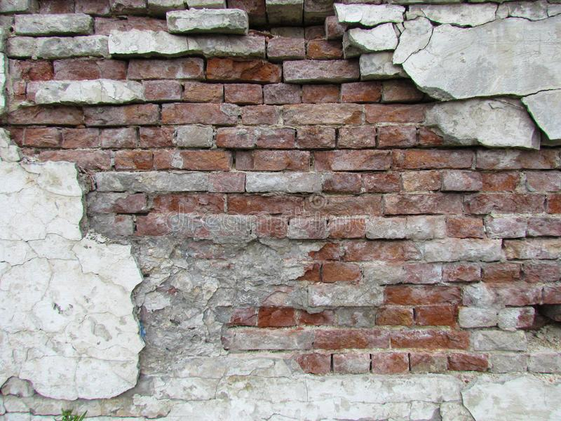 Old wall. Vintage decor. Old plaster and brick royalty free stock images
