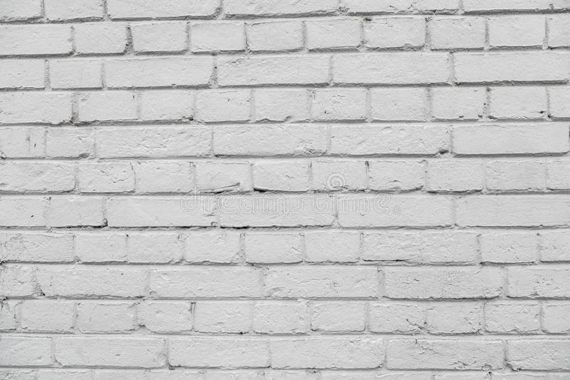 Wall from a white brick with a regular laying. Old wall from a white brick with a regular laying background stock photo
