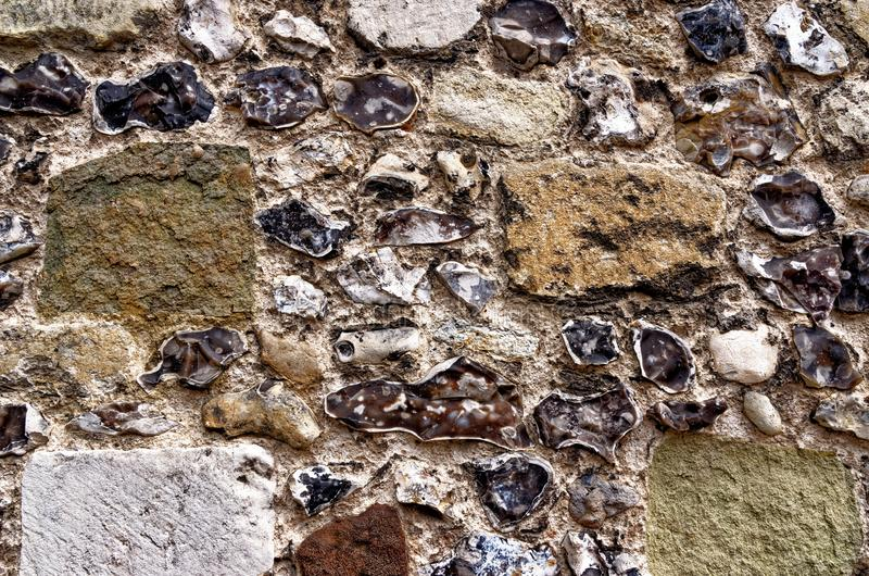 Old wall in Winchester - Texture. Old wall in Winchester - United Kingdom - Vintage english architecture stock photo