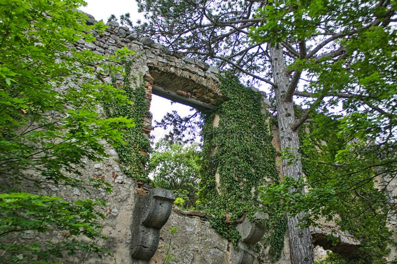old wall with a window hole from a castle stock photos