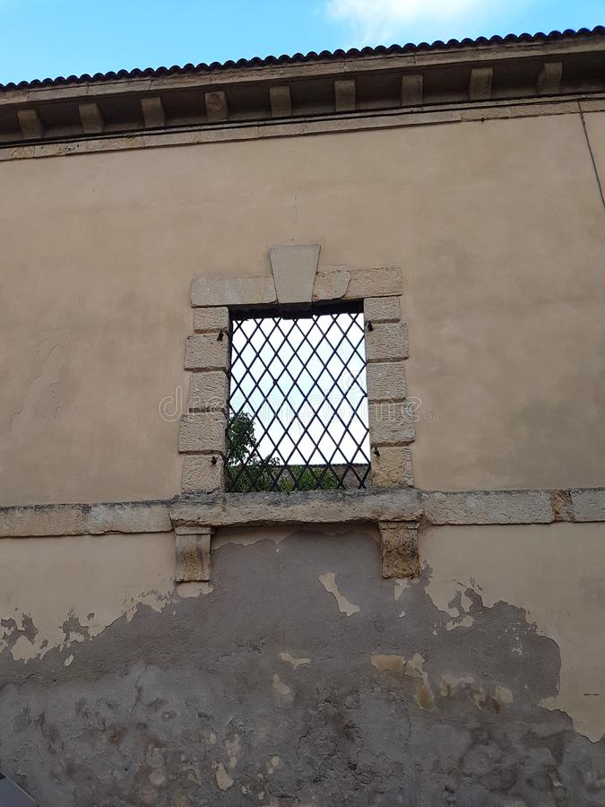 Old wall with a window stock photo