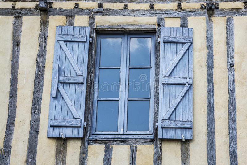 Old wall with window and open shutters. Old wall with wood beams and Open shutters royalty free stock photography