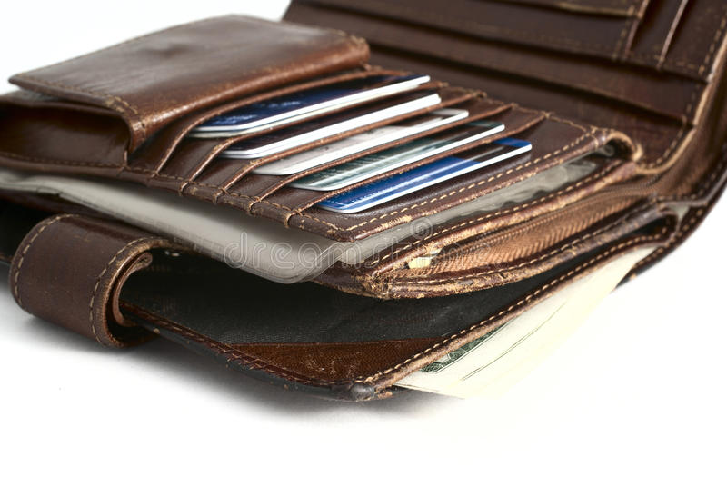 Old wallet. With credit cards isolated on white background royalty free stock photo