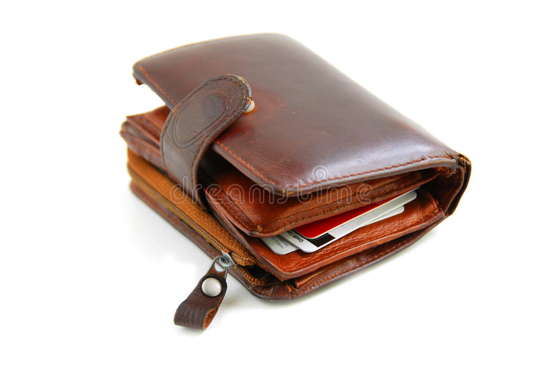 Old wallet. Old leather wallet full of credit cards on white background royalty free stock photography