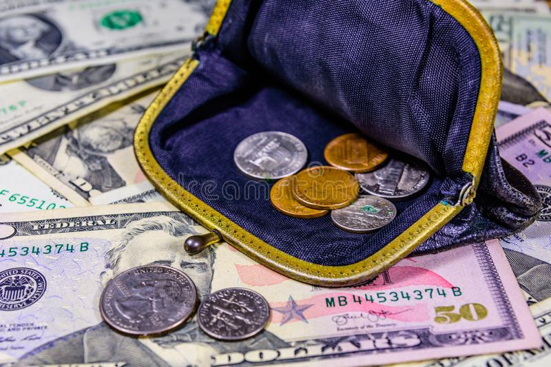 Old wallet with american cent coins over the dollar banknotes. Old wallet with american cent coins over dollar banknotes stock photo