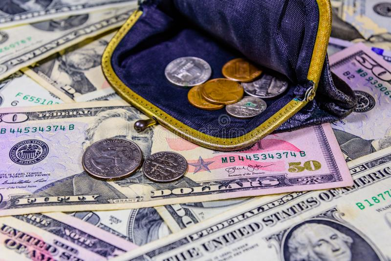 Old wallet with american cent coins over the dollar banknotes. Old wallet with american cent coins over dollar banknotes stock image
