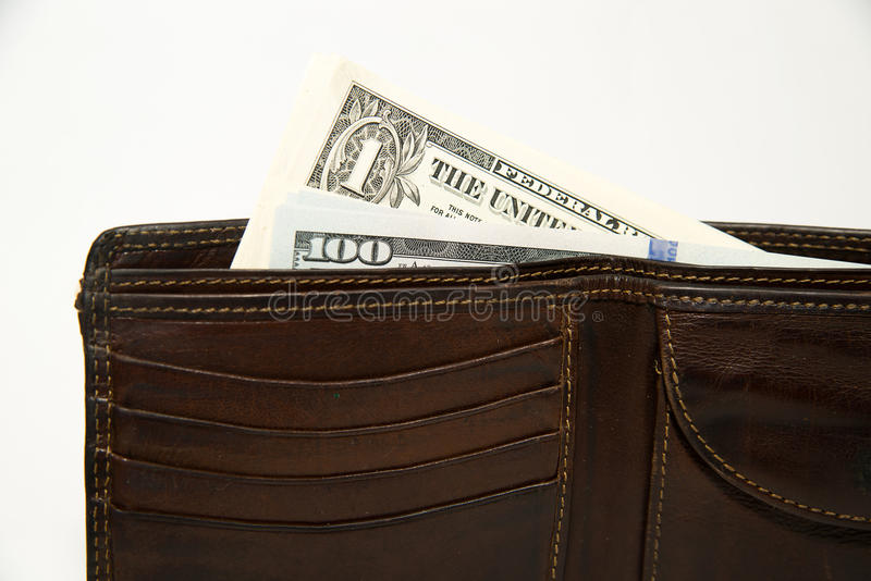 Old wallet with banknotes of US dollars inside. Old leather wallet with banknotes of US dollars inside stock images