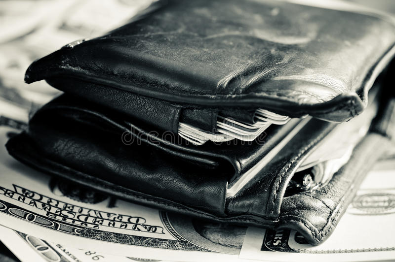 An old wallet. On the dollar banknotes stock image