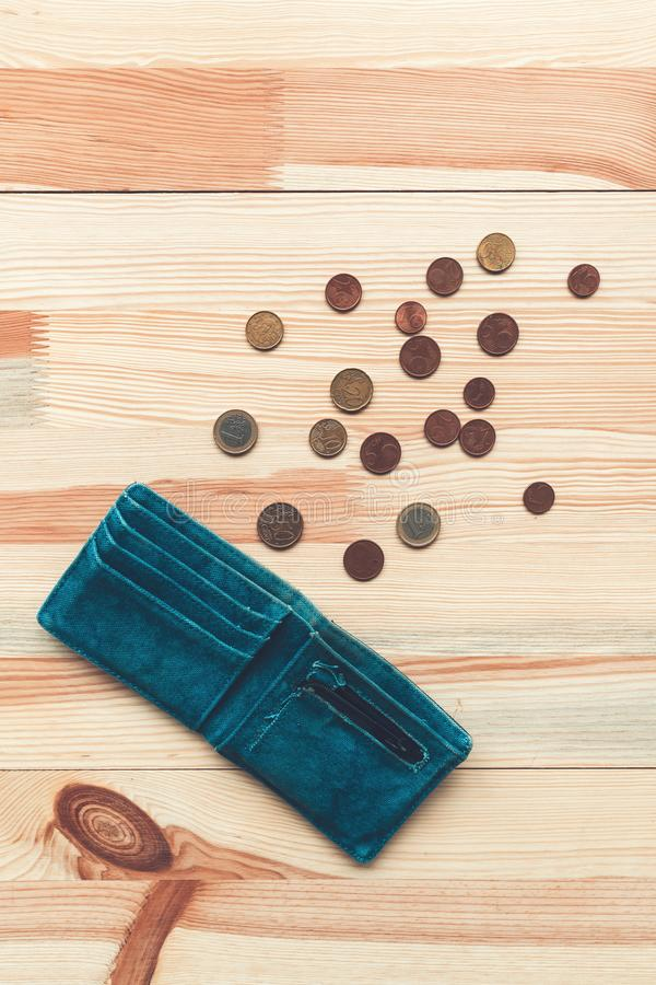 Old wallet and Euro coins. On the table royalty free stock photography