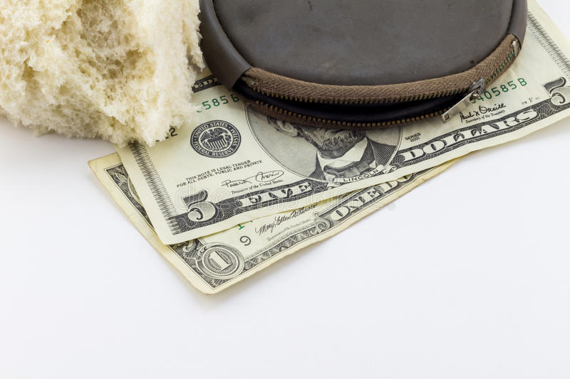 Old wallet / purse with dollar notes and a crust of bread. On white background - conceptual image depicting poverty bread line in America - economic crises stock photos