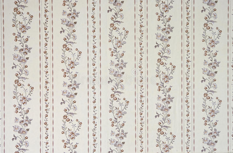 Old wallpaper. Old beige wallpaper for texture or background stock photography