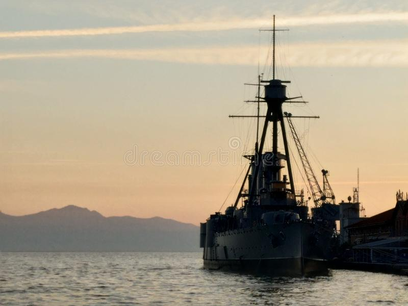 Old war ship in harbor of Thessaloniki Greece. Old war ship in sunset, harbor of Thessaloniki Greece, destroyer, background, idyllic, shadow stock images