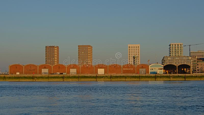 Old warehouse and new residentail skyscrapers in Anwerp royalty free stock photography