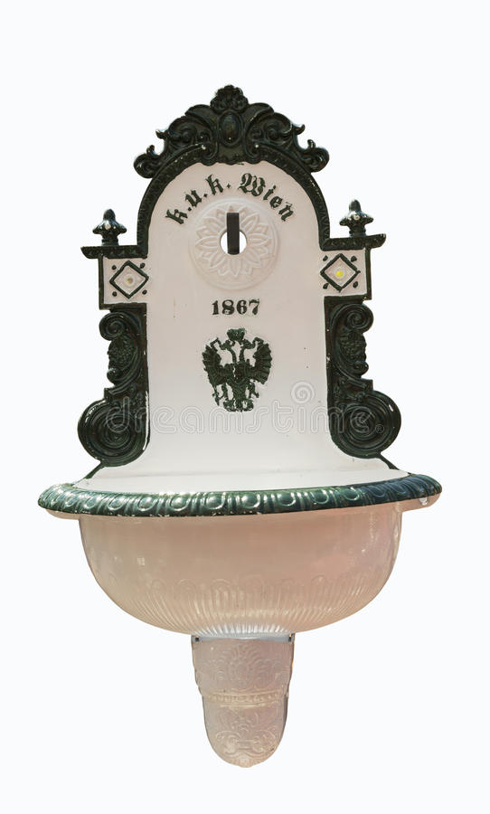 Old washbasin. Old public washbasin from the Wien, Austria with emperor coat of arms royalty free stock photography