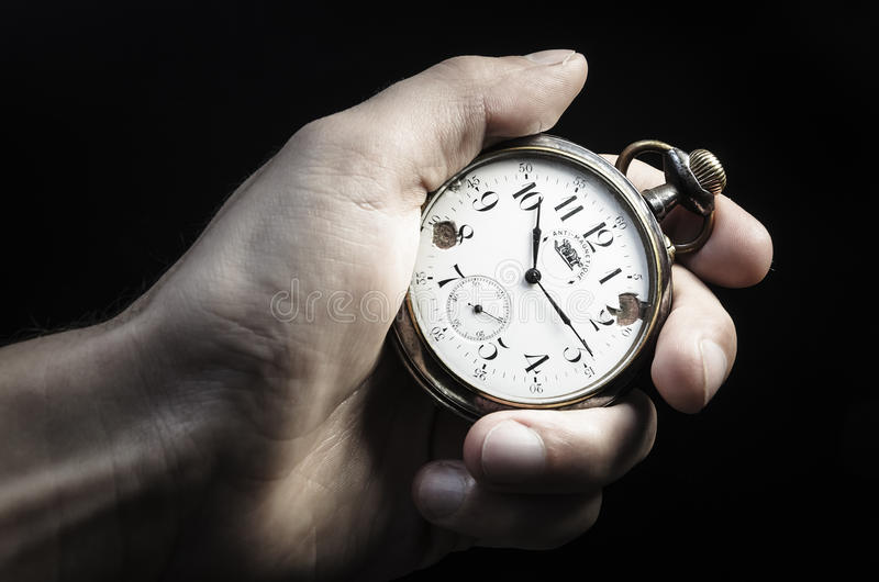 Old watch in hand. Old pocket watch in hand stock image