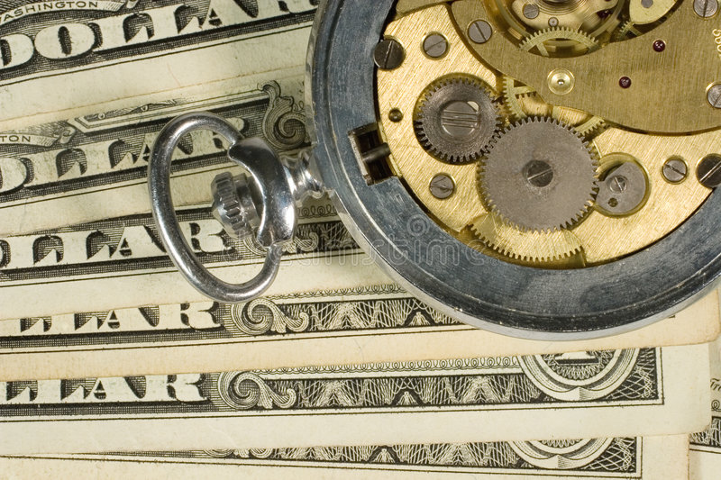 Old watch mechanism and dollars stock photography