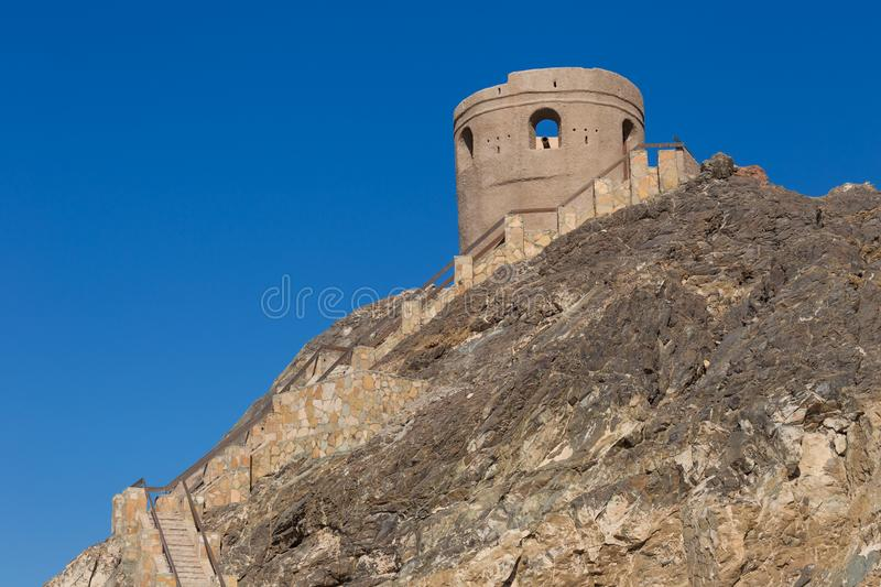 Old Watch Tower in Muscat, Oman. Old Watch Tower on the seafront between Mutrah and Old Muscat royalty free stock images
