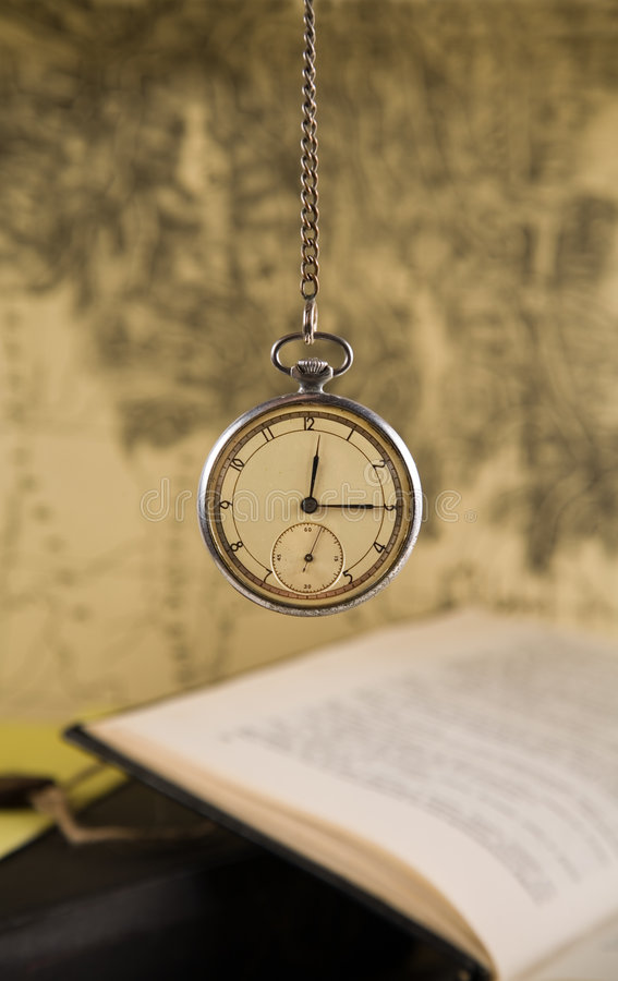 Old watches over blurred map background stock photos