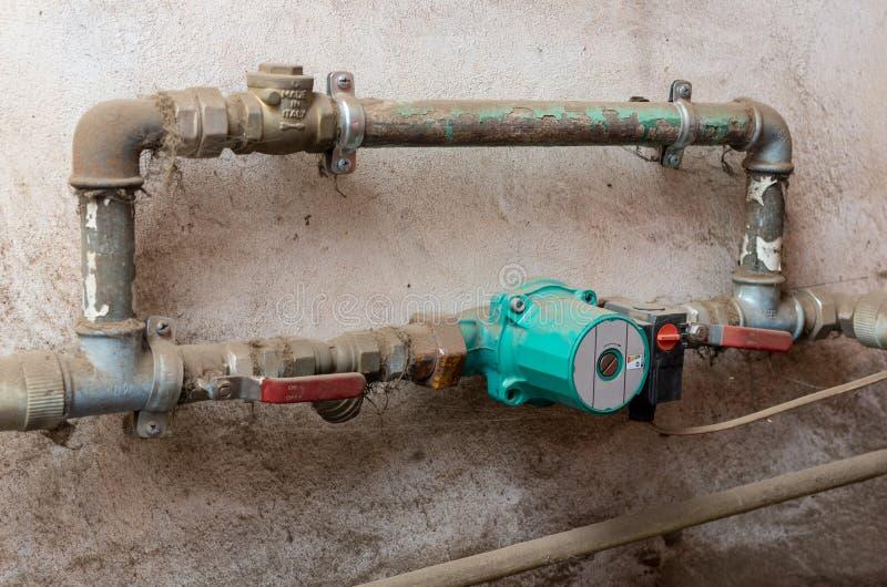 Old water circulating pump. Old circulating pump for water heating systems royalty free stock image